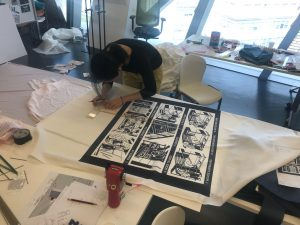 student hard at work putting together the exhibition